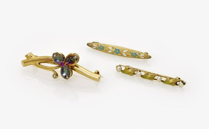 Three floral art nouveau pins decorated with pearls