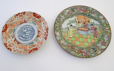 Two oriental plates, one decorated with flowers