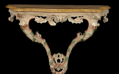 A pair of Italian carved and polychrome painted wood console tables, circa 1770