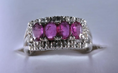 14k white gold, diamond, and ruby ring. Contains four