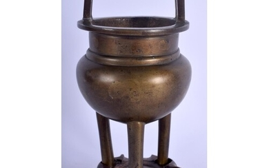 A 19TH CENTURY CHINESE TWIN HANDLED BRONZE CENSER Late Qing,...
