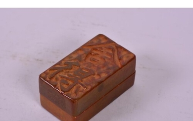 A Chinese amber soapstone box and seal with carved character...