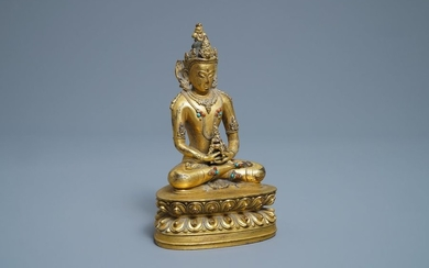 A Chinese coral and turquoise inlaid gilt bronze...