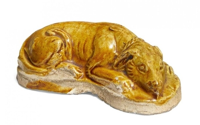 A Chinese pottery amber glazed dog, Tang dynasty, modelled in...