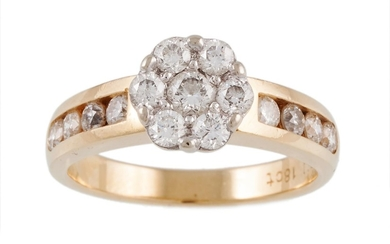 A DIAMOND DAISY CLUSTER RING, mounted in 18ct yellow gold, w...