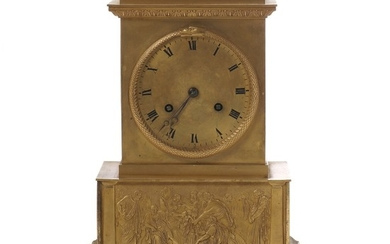 A French Empire gilt bronze mantel clock with Roman numerals in black, the base with classis figures in relif. Early 19th century. H. 31 cm. W. 22 cm. D. 13 cm.