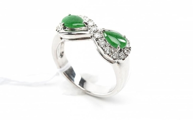 A JADE AND DIAMOND RING WITH TYPE A JADE CERTIFICATION IN 18CT WHITE GOLD
