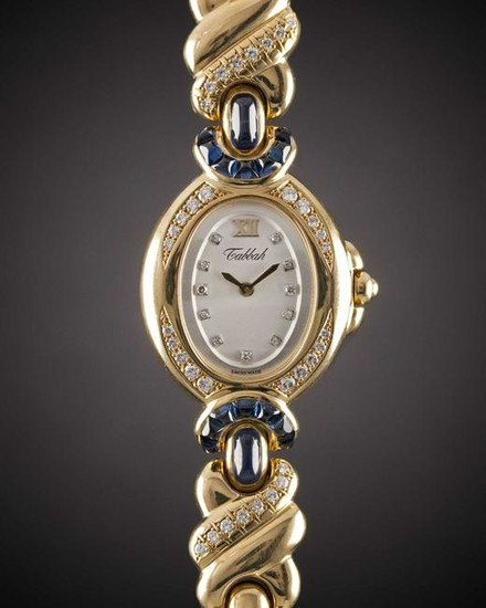 A LADIES 18K SOLID GOLD, DIAMOND & SAPPHIRE TABBAH