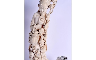 A LARGE 19TH CENTURY CHINESE CARVED IVORY FIGURE OF A STANDI...