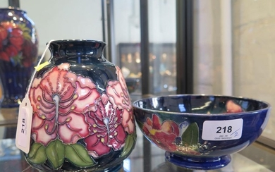 A Moorcroft Pottery pink orchid design tapering vase, dated ...