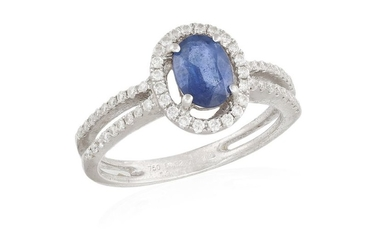 A SAPPHIRE AND DIAMOND RING, the oval-shaped sapphire...