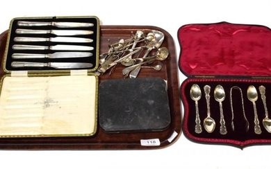 A collection of silver flatware, including: a paper knife applied...