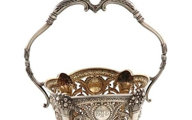 A continental silver swing-handled sugar basket, with a...