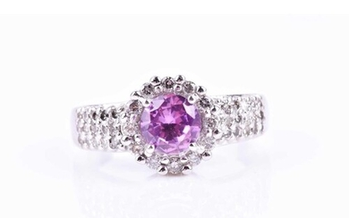 A diamond and pink topaz cocktail ring, set with a round-cut...