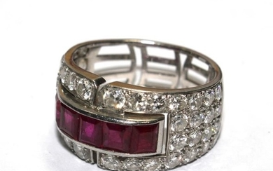 A diamond and ruby ring, in the form of a four row half eter...