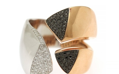 A diamond ring set with numerous black and white brilliant-cut diamonds, totalling app. 0.48 ct., mounted in 18k white and rose gold. Size 56.