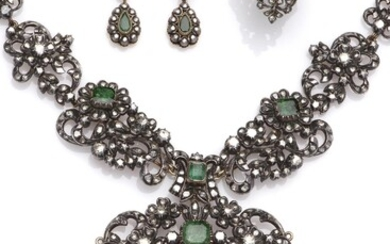 A gold and silver emerald and diamond parure
