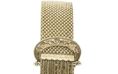 A gold mesh bracelet with buckle clasp