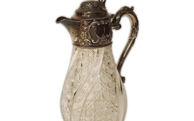A hallmarked silver and clear glass claret jug, the baluster...