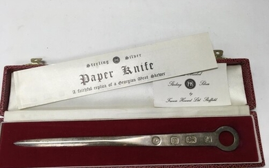 A hallmarked silver meat skewer paper knife by Francis Howar...