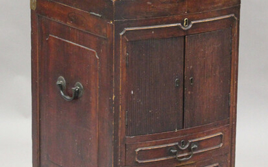 A late 18th century Anglo-Chinese elm gentleman's washstand, the hinged top enclosing a rising
