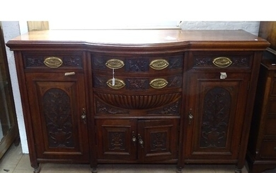 A late Victorian mahogany bow-front sideboard, with fitted d...