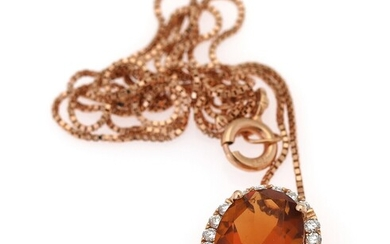 A necklace with a pendant set with a citrine encirlced by numerous diamonds, mounted in...