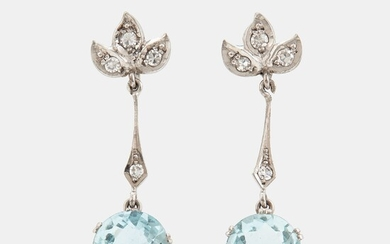 A pair of 18K white gold earrings set with faceted aquamarines and eight-cut diamonds