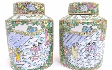 A pair of Chinese jars and covers profusely decorated