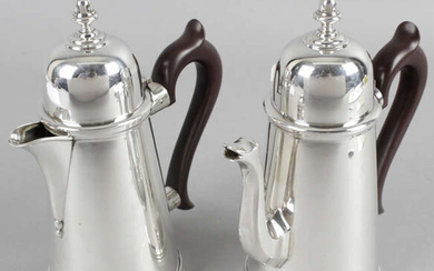 A pair of Queen Anne style silver coffee pot and hot water jugs.