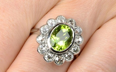 A peridot and old-cut diamond floral cluster ring.