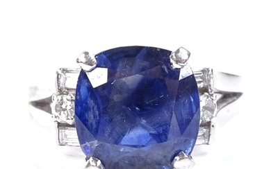 A platinum sapphire and diamond dress ring, set with cushion...