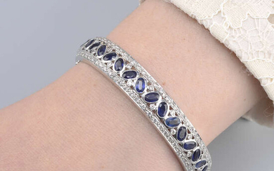 A sapphire and brilliant-cut diamond hinged bangle.