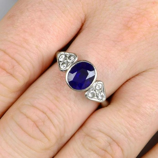 A sapphire and diamond dress ring.Estimated dimensions