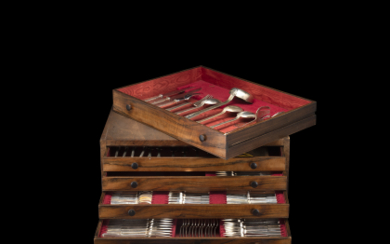 A silver flatware in wooden case. Italy, 1930-40. Silversmith...