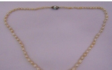 A single strand of Baroque Akoya graduated pearls with a whi...