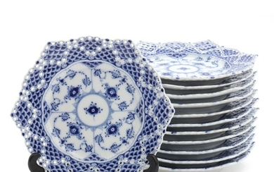 """Blue Fluted Full Lace"". A set of 12 Royal Copenhagen porcelain pastry plates with double lace border. Diam. 17 cm. (12)"