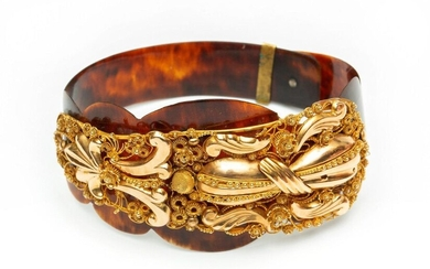Bracelet, made of a golden spring, decorated with...