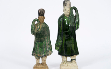 """CHINA - MING DYNASTION (1368 - 1644) two tombs in pottery with typical green glaze : """"Hofdienaars"""" - heights : 20 and 22,5 cm   two Chinese Ming Dynasty tomb figures in partially glazed earthenware"""