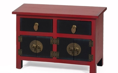 """CHINESE PAINTED WOOD CABINET Red case fitted with two black drawers over two black cabinet doors. Brass hardware. Height 15"""". Width..."""