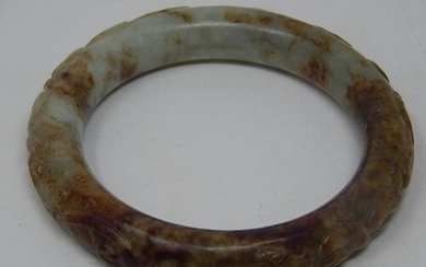 Chinese Jade Bangle Carved in Bas Relief.