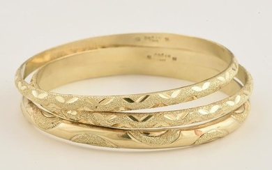 Collection of Three 14k Yellow Gold Bangle Bracelets.