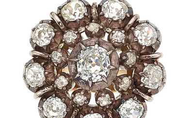 Diamond, Silver-Topped Gold Ring The ring centers an mine-cut...