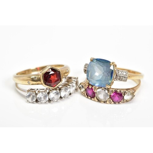 FOUR 9CT GOLD GEM SET RINGS, the first collet set with a cen...