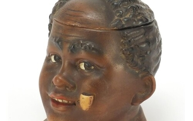Hand painted porcelain Blackamoor tobacco jar and cover, 11....
