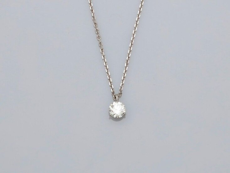 Necklace in white gold, 750 MM, centered on a diamond weighing 0.90 carat approximately, length 40 cm, spring ring, weight: 5.2gr. rough.