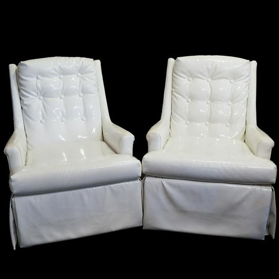 Pair Of Mid Century Tufted Swivel Arm Chairs