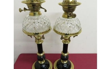 Pair of elaborate 19th C oil lamps with ebonised columns and...