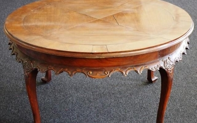 Vintage round hardwood coffee table with scroll carved flare...