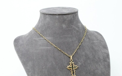 18k (750) yellow gold cross with calibrated sapphires and 18k (750) yellow gold chain.